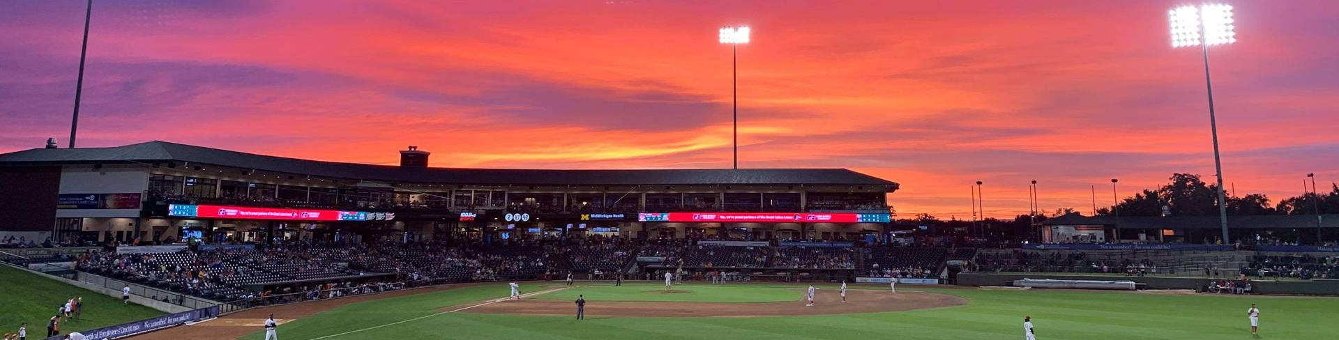 A sunset over Dow Diamond during a Great Lakes Loons baseball game