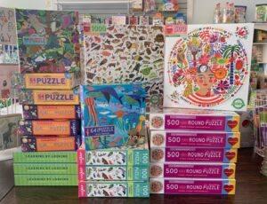 Retail display of puzzles at Joyful Tantrum